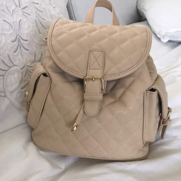 88997832893e Forever 21 Handbags - cream quilted mini backpack
